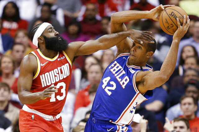 Philadelphia 76ers center Al Horford (42) looks to pass the ball as Houston Rockets guard James Harden defends during the first half of an NBA basketball game Friday, Jan. 3, 2020, in Houston. (AP Photo/Eric Christian Smith)