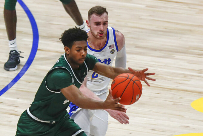 Binghamton's Brenton Mills, left, reaches for a loose ball as Pittsburgh's Ryan Murphy pursues during the second half of an NCAA college basketball game Friday, Dec. 20, 2019, in Pittsburgh. Pittsburgh won 79-53. (AP Photo/Keith Srakocic)