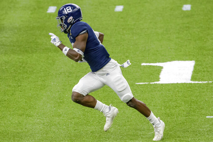 Georgia Southern cornerback Justin Birdsong (18) returns an interception against Louisiana Tech during the first half of the New Orleans Bowl NCAA college football game in New Orleans, Wednesday, Dec. 23, 2020. (AP Photo/Matthew Hinton)