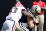 Georgia linebacker Robert Beal Jr. (33) sacks Vanderbilt quarterback Ken Seals for a 10-yard loss in the second half of an NCAA college football game Saturday, Sept. 25, 2021, in Nashville, Tenn. Georgia won 62-0. (AP Photo/Mark Humphrey)