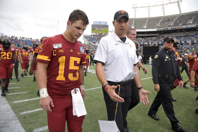 FILE - Iowa State head coach Matt Campbell, center, walks off the field with quarterback Brock Purdy after the Camping World Bowl NCAA college football game against Notre Dame Saturday, Dec. 28, 2019, in Orlando, Fla. Iowa State enters this season off its second-best three-year stretch in program history and with its sights set on doing something it's never done — make the Big 12 championship game. (AP Photo/Phelan M. Ebenhack, File)