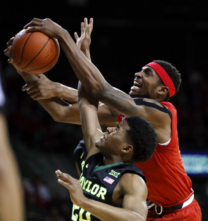Baylor's Jared Butler, bottom, and Texas Tech forward Tariq Owens, top, compete for a rebound during the first half of an NCAA college basketball game Saturday, Jan. 19, 2019, in Waco, Texas. (AP Photo/Tony Gutierrez)