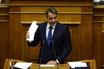 Greek opposition New Democracy party leader Kyriakos Mitsotakis speaks during a parliament session in Athens, Friday, Feb. 8, 2019. Greek lawmakers are set Friday to approve Macedonia's NATO accession, ending a process to normalize relations between the two neighbors and anchor the country — renamed North Macedonia — firmly within the western sphere of influence. (AP Photo/Thanassis Stavrakis)