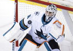 San Jose Sharks goalie Martin Jones catches the puck during the second period of an NHL hockey game against the Vancouver Canucks in Vancouver, British Columbia, on Monday, Feb. 11, 2019. (Darryl Dyck/The Canadian Press via AP)
