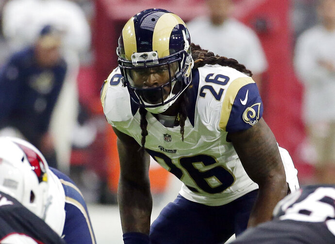 FILE - In this Oct. 2, 2016, file photo, Los Angeles Rams outside linebacker Mark Barron (26) looms over the line of scrimmage during an NFL football game against the Arizona Cardinals in Glendale, Ariz. The Pittsburgh Steelers signed Barron to a two-year deal on Tuesday, March 19, 2019.  (AP Photo/Rick Scuteri, File)
