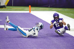 Minnesota Vikings wide receiver Chad Beebe catches a 10-yard touchdown pass over Carolina Panthers cornerback Corn Elder, left, during the second half of an NFL football game, Sunday, Nov. 29, 2020, in Minneapolis. The Vikings won 28-27. (AP Photo/Bruce Kluckhohn)
