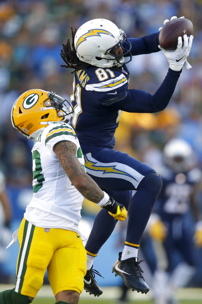 Los Angeles Chargers wide receiver Mike Williams catches a pass over Green Bay Packers cornerback Jaire Alexander during the second half of an NFL football game Sunday, Nov. 3, 2019, in Carson, Calif.(AP Photo/Marcio Jose Sanchez)