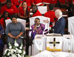 Democratic presidential candidate and former Vice President Joe Biden, right, pays compliments to former Georgia gubernatorial candidate and former state Rep. Stacey Abrams while speaking at Brown Chapel African Methodist Episcopal Church, Sunday, March 1, 2020, in Selma, Ala. (Curtis Compton/Atlanta Journal-Constitution via AP)