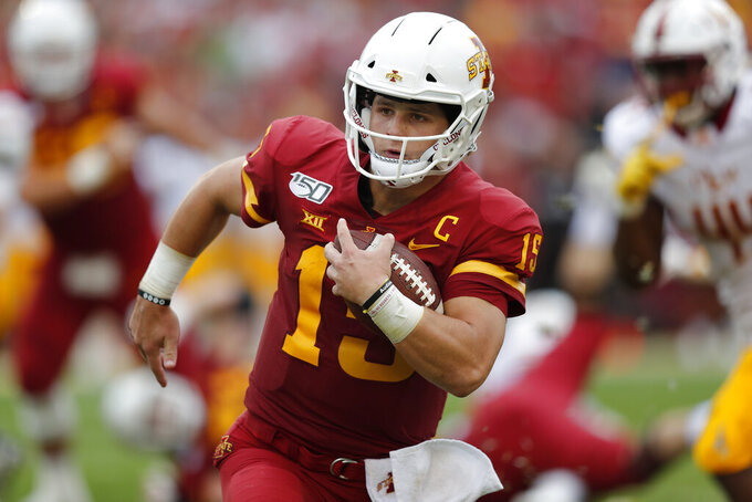 RETRANSMISSION TO CORRECT DATE - Iowa State quarterback Brock Purdy runs the ball for a first down against Louisiana-Monroe during the first half of an NCAA college football game, Saturday, Sept. 21, 2019, in Ames, Iowa. (AP Photo/Matthew Putney)