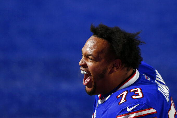 Buffalo Bills offensive tackle Dion Dawkins (73) celebrates after an NFL divisional round football game against the Baltimore Ravens Saturday, Jan. 16, 2021, in Orchard Park, N.Y. The Bills won 17-3. (AP Photo/John Munson)