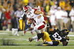 Miami of Ohio quarterback Brett Gabbert is sacked by Iowa linebacker Amani Jones (52) during the second half of an NCAA college football game, Saturday, Aug. 31, 2019, in Iowa City, Iowa. Iowa won 38-14. (AP Photo/Charlie Neibergall)
