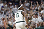 Michigan State guard Cassius Winston looks towards the fans after a 3-point basket during the second half of an NCAA college basketball game against Northwestern, Wednesday, Jan. 29, 2020, in East Lansing, Mich. (AP Photo/Carlos Osorio)