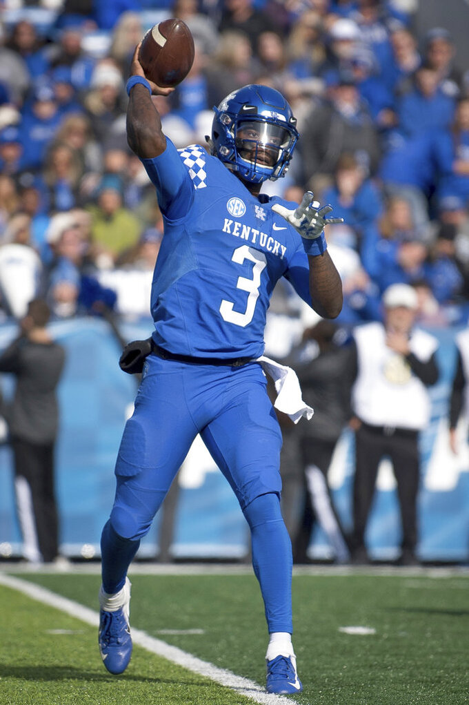 Kentucky quarterback Terry Wilson (3) passes the ball during the first half of an NCAA college football game against Middle Tennessee in Lexington, Ky., Saturday, Nov. 17, 2018. (AP Photo/Bryan Woolston)