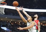 Milwaukee Bucks' Malcolm Brogdon shoots past Toronto Raptors' Fred VanVleet during the first half of Game 5 of the NBA Eastern Conference basketball playoff finals Thursday, May 23, 2019, in Milwaukee. (AP Photo/Morry Gash)