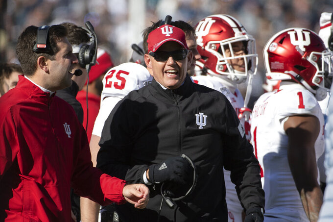 """FILE - In this Nov. 16, 2019, file photo, Indiana coach Tom Allen watches the second quarter of the team's NCAA college football game against Penn State in State College, Pa. The Big Ten and Pac-12 became the first Power Five conferences to cancel their fall football seasons because of concerns about COVID-19. The Big Ten said it hopes to compete in the spring, and the Pac-12 pushed even basketball back to Jan. 1. """"My heart breaks for our players. I couldn't be prouder of the commitment and focus they have demonstrated from the start of this pandemic,"""" Allen said of the Big Ten's decision Tuesday, Aug. 11. (AP Photo/Barry Reeger, File)"""