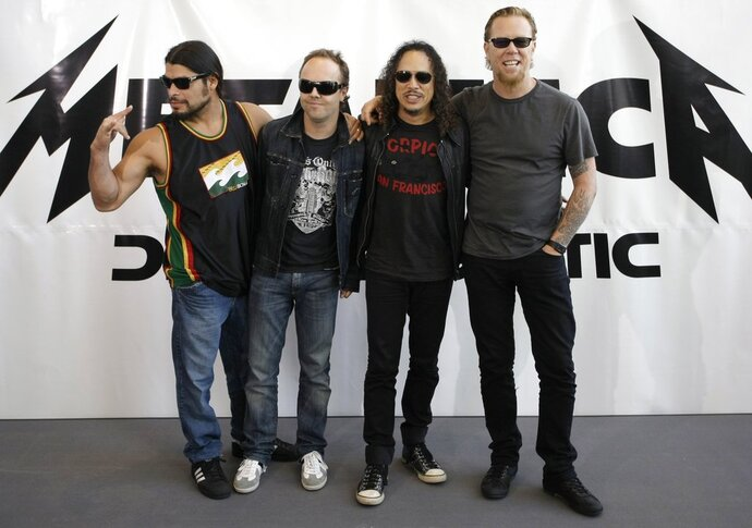 FILE - This is a Friday, Sept. 12, 2008 file photo of member of rock backs  Metallica Robert Trujillo, Lars Ulrich, Kirk Hammett and James Hetfield, from left, as they pose for the media while promoting their new album 'Death Magnetic' in Berlin. American heavy metal band Metallica and Afghanistan's National Institute of Music it was announced Wednesday Feb. 14, 2018 have won the 2018 Polar Music Prizes, a Swedish award. It is the first time a heavy metal band gets an award given each year for significant achievements in music. The award panel said Metallica has taken rock music