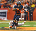 Syracuse wide receiver Sean Riley, top, tries to break the grasp of North Carolina State defensive back Stephen Griffin after a reception during the second half of an NCAA college football game in Syracuse, N.Y., Saturday, Oct. 27, 2018. (AP Photo/Adrian Kraus)