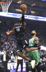 Sacramento Kings forward Harrison Barnes goes to the basket past Boston Celtics forward Marcus Morris during the first quarter of an NBA basketball game Wednesday, March 6, 2019, in Sacramento, Calif. (AP Photo/Rich Pedroncelli)