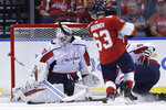 Florida Panthers right wing Evgenii Dadonov (63) scores a goal against Washington Capitals goaltender Braden Holtby (70) during the second period of an an NHL hockey game, Thursday, Nov. 7, 2019, in Sunrise, Fla. (AP Photo/Lynne Sladky)