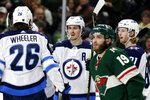 Winnipeg Jets center Mark Scheifele (55) is congratulated by teammates Jets' Blake Wheeler (26) and Jets' Kyle Connor (21) after scoring a goal as Minnesota Wild center Luke Kunin (26) skates off in the first period of an NHL hockey game Saturday, Jan. 4, 2020, in St. Paul, Minn. (AP Photo/Andy Clayton-King)