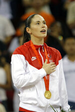 FILE - In this Aug. 23, 2008, file photo, Sue Bird, of the United States, sings the national anthem during the gold medal ceremony for women's basketball at the Beijing 2008 Olympics in Beijing. Sue Bird and Diana Taurasi will try and become the first five-time Olympic gold medalists in basketball as they lead the U.S women's team at the Tokyo Games. The duo was selected for their fifth Olympics on Monday, June 21, 2021, joining Teresa Edwards as the only basketball players in U.S. history to play in five.(AP Photo/Dusan Vranic, File)