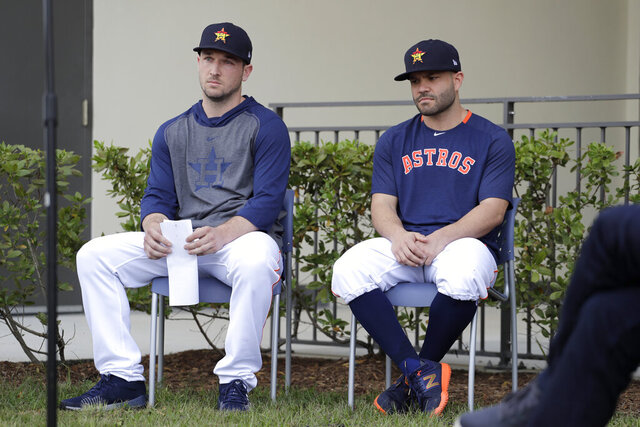 Houston Astros infielder Alex Bregman, left, and teammate Jose Altuve sit in chairs as the wait to deliver statements during a news conference before the start of the first official spring training baseball practice for the team Thursday, Feb. 13, 2020, in West Palm Beach, Fla. (AP Photo/Jeff Roberson) ;