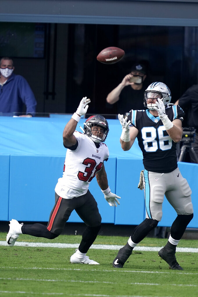 Carolina Panthers tight end Colin Thompson (86) prepares to make a touchdown catch against Tampa Bay Buccaneers strong safety Antoine Winfield Jr. (31) during the first half of an NFL football game, Sunday, Nov. 15, 2020, in Charlotte , N.C. (AP Photo/Gerry Broome)