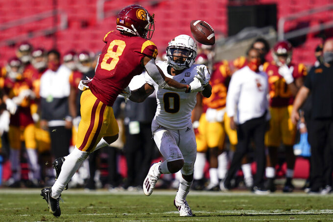 Southern California wide receiver Amon-Ra St. Brown (8) and Arizona State defensive back Jack Jones (0) reach for an incomplete pass during the first half of an NCAA college football game Saturday, Nov. 7, 2020, in Los Angeles. (AP Photo/Ashley Landis)