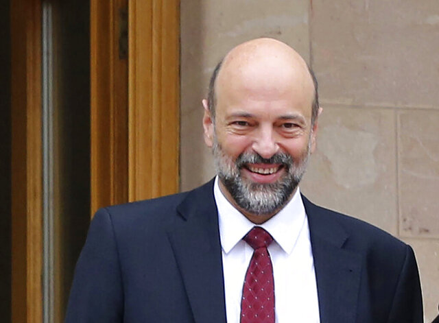 """FILE - This Jan. 15, 2017 file photo, shows then newly appointed Education Minister Omar Razzaz, following a meeting at the Royal Palace, in Amman, Jordan. Razzaz told the UK's Guardian newspaper in an interview published Tuesday, July 21, 2020, that the kingdom would look """"positively"""" on the creation of a binational state that guarantees equal rights to Israelis and Palestinians if Israel's proposed annexation of parts of the occupied West Bank closes the door on a two-state solution. (Khalil Mazraawi, Pool via AP, File)"""