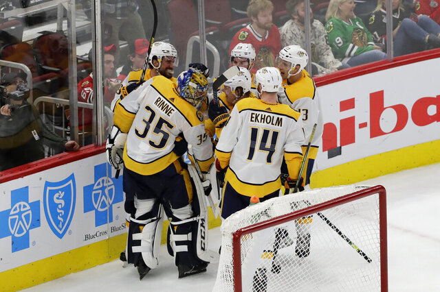 Nashville Predators goalie Pekka Rinne (35), celebrates with teammates after scoring a goal against the Chicago Blackhawks during the third period of an NHL hockey game in Chicago, Thursday, Jan. 9, 2020. (AP Photo/Nam Y. Huh)