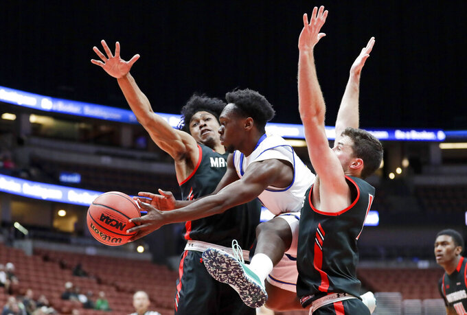 UC Santa Barbara guard Devearl Ramsey, passes between Cal State Northridge guard Rodney Henderson Jr., left, and guard Cameron Gottfried during the first half of a NCAA college basketball game at the Big West men's tournament in Anaheim, Calif., Thursday, March 14, 2019. (AP Photo/Chris Carlson)