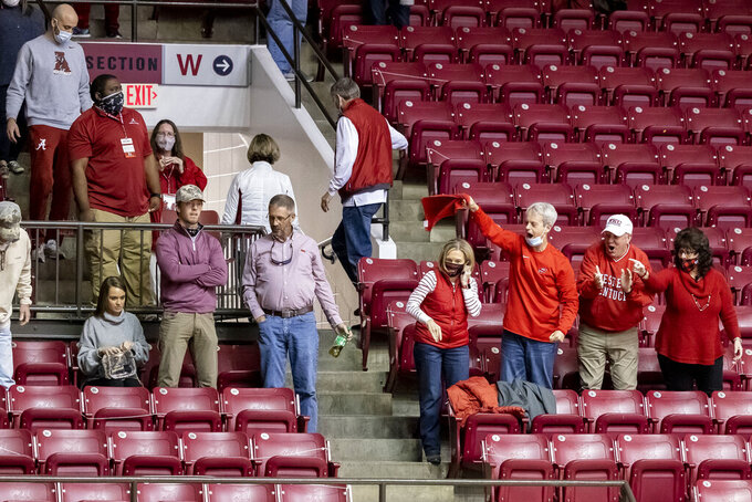 Western Kentucky fans cheer their team as they depart the floor with a 73-71 road win over Alabama in an NCAA college basketball game, Saturday, Dec. 19, 2020, in Tuscaloosa, Ala. (AP Photo/Vasha Hunt)