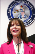 Miami-Dade State Attorney Katherine Fernandez Rundle smiles as she speaks during a news conference on the arrest of the