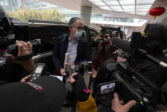FILE - In this file photo dated Wednesday, Feb. 10, 2021, Peter Ben Embarek of a World Health Organization team speaks to journalists as he arrives at the airport to leave, at the end of their WHO mission to investigate the origins of the coronavirus pandemic in Wuhan in central China's Hubei province. When WHO traveled to China earlier this year to investigate the origins of the COVID-19 pandemic,  Peter Ben Embarek said he was worried about biosafety standards at a laboratory close to the market where the first human cases were detected, according to a documentary released Thursday Aug. 12, 2021, by TV2, a Danish television channel.   (AP Photo/Ng Han Guan, FILE)