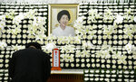 A mourner pays tribute at a memorial altar for the deceased Lee Hee-ho, a wife of the late former South Korean President Kim Dae-jung, at a hospital in Seoul, South Korea, Tuesday, June 11, 2019.  Lee, a South Korean feminist activist who fought for democracy against dictatorships alongside her husband and future President Kim, has died. She was 96.(Ahn Jung-won/Yonhap via AP)