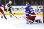 New York Rangers goaltender Henrik Lundqvist (30) make a save against Boston Bruins center Charlie Coyle (13) during the first period of an NHL hockey game, Sunday, Oct. 27, 2019, at Madison Square Garden in New York. (AP Photo/Mary Altaffer)
