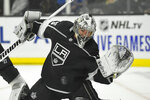 Los Angeles Kings goaltender Jack Campbell attempts a glove save during the first period of the team's NHL hockey game against the Carolina Hurricanes on Tuesday, Oct. 15, 2019, in Los Angeles. (AP Photo/Mark J. Terrill)