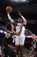 Southern California guard Jonah Mathews, center, shoots as Colorado guard Shane Gatling, left, and forward Alexander Strating defend during the second half of an NCAA college basketball game Saturday, Feb. 9, 2019, in Los Angeles. Colorado won 69-65. (AP Photo/Mark J. Terrill)