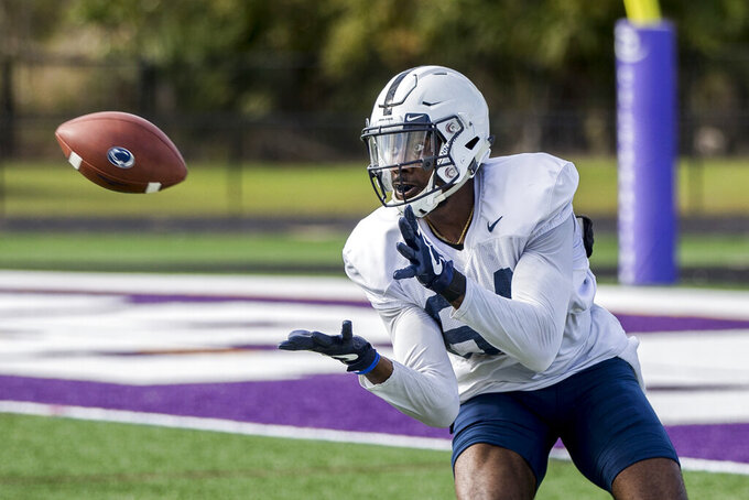 FILE - In this Dec. 29, 2018, file photo, Penn State wide receiver Juwan Johnson hauls in a pass during practice for the Citrus Bowl NCAA college football game in Orlando, Fla. Johnson caught 25 passes for 352 yards and one touchdown last season but was more productive in 2017, when he had 54 receptions for 701 yards. He graduated in December and now heads to Oregon, where he could have a big season catching passes from potential first-round draft pick Justin Herbert. (Joe Hermitt/The Patriot-News via AP, File)
