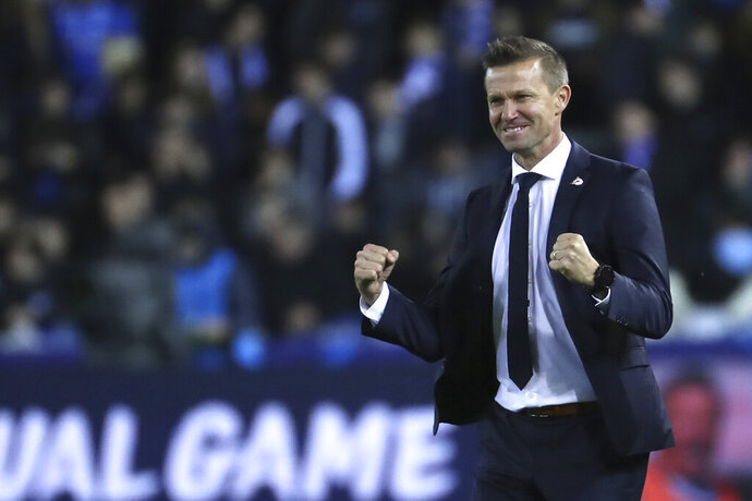 FILE - In this file photo dated Wednesday, Nov. 27, 2019, Salzburg soccer coach Jesse Marsch stands on the sidelines during a Champions League group E soccer match against Genk at the KRC Genk Arena in Genk, Belgium. Marsch led Salzburg to this season's Austrian league title, the most significant trophy won by an American coach in Europe, and says he wanted