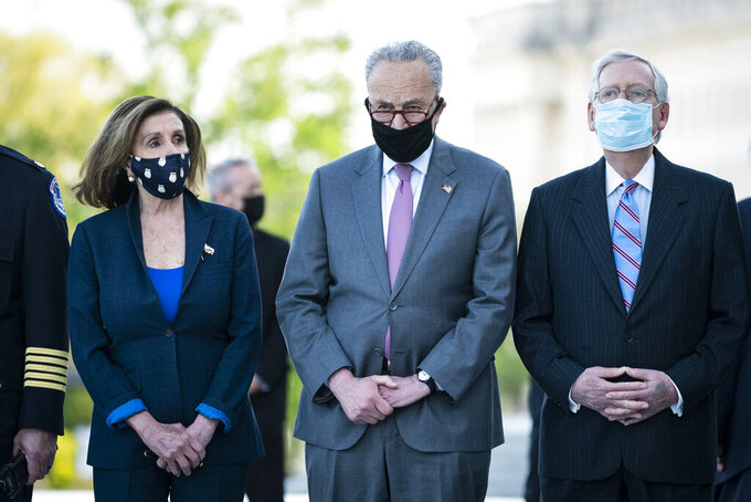 """From left, House Speaker Nancy Pelosi of Calif., Senate Majority Leader Chuck Schumer of N.Y., and Senate Minority Leader Mitch McConnell of Ky., wait for the flag-draped casket of U.S. Capitol Police officer William """"Billy"""" Evans, to be carried from the Capitol by a joint services honor guard Washington, Tuesday, April 13, 2021. (Jabin Botsford/The Washington Post via AP, Pool)"""