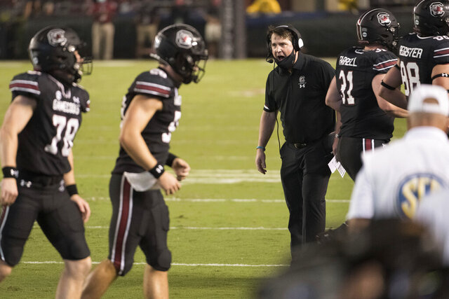 South Carolina coach Will Muschamp shouts to players during the second half of the team's NCAA college football game against Tennessee on Saturday, Sept. 26, 2020, in Columbia, S.C. Tennessee won 31-27. (AP Photo/Sean Rayford)
