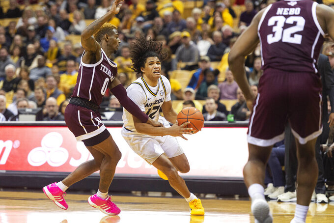 Missouri's Dru Smith, right, dribbles around Texas A&M's Jay Jay Chandler, left, during the second half of an NCAA college basketball game Tuesday, Jan. 21, 2020, in Columbia, Mo. Texas A&M won the game 66-64. (AP Photo/L.G. Patterson)