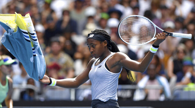Coco Gauff of the U.S. reacts after losing a point to compatriot Sofia Kenin during their fourth round singles match at the Australian Open tennis championship in Melbourne, Australia, Sunday, Jan. 26, 2020. (AP Photo/Andy Brownbill)