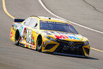 Kyle Busch (18) goes through turn one during a NASCAR Cup Series auto race at Pocono Raceway, Sunday, June 27, 2021, in Long Pond, Pa. Busch won the race. (AP Photo/Matt Slocum)