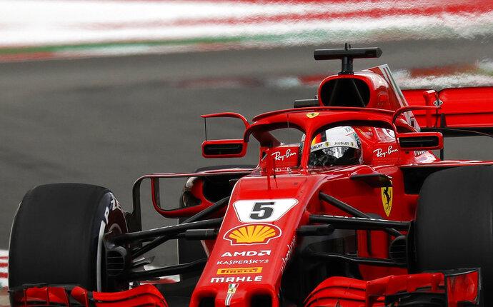 Ferrari driver Sebastian Vettel of Germany steers his car during the Spanish Formula One Grand Prix at the Barcelona Catalunya racetrack in Montmelo, Spain, Sunday, May 13, 2018. (AP Photo/Manu Fernandez)