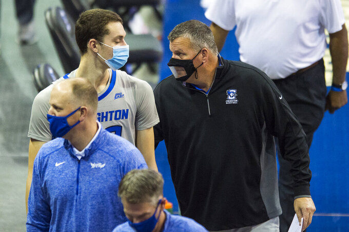 Creighton head coach Greg McDermott, right, talks with Ryan Kalkbrenner, left, as they walk off the court following their win over North Dakota State in an NCAA college basketball game in Omaha, Neb., Sunday, Nov. 29, 2020. (AP Photo/Kayla Wolf)