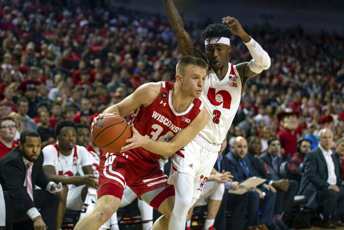 Wisconsin guard Brad Davison (34) bumps Nebraska guard Cam Mack (3) to set up for a shot during the first half of an NCAA college basketball game in Lincoln, Neb., Saturday, Feb. 15, 2020. (AP Photo/John Peterson)