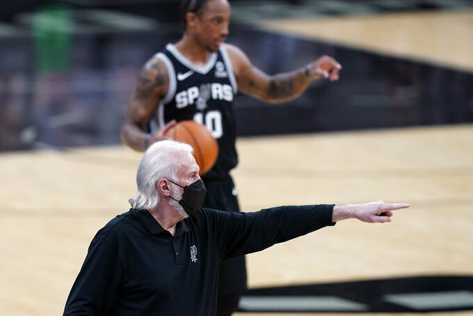 San Antonio Spurs coach Gregg Popovich directs players during the first half of an NBA basketball game against the New Orleans Pelicans in San Antonio, Saturday, Feb. 27, 2021. (AP Photo/Eric Gay)