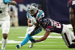 Carolina Panthers running back Christian McCaffrey (22) catches a pass as Houston Texans cornerback Vernon Hargreaves III (26) tackles him during the first half of an NFL football game Thursday, Sept. 23, 2021, in Houston. (AP Photo/Eric Christian Smith)